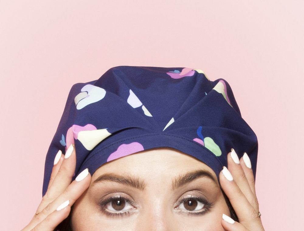 The rubber grip on the SHHHOWERCAP holds the shower cap in place and the elastic will never snap. The Posey Blue Floral Print SHHHOWERCAP Shower Cap modeled by Taylor Lashae. All Rights Reserved, SHHHOWERCAP.