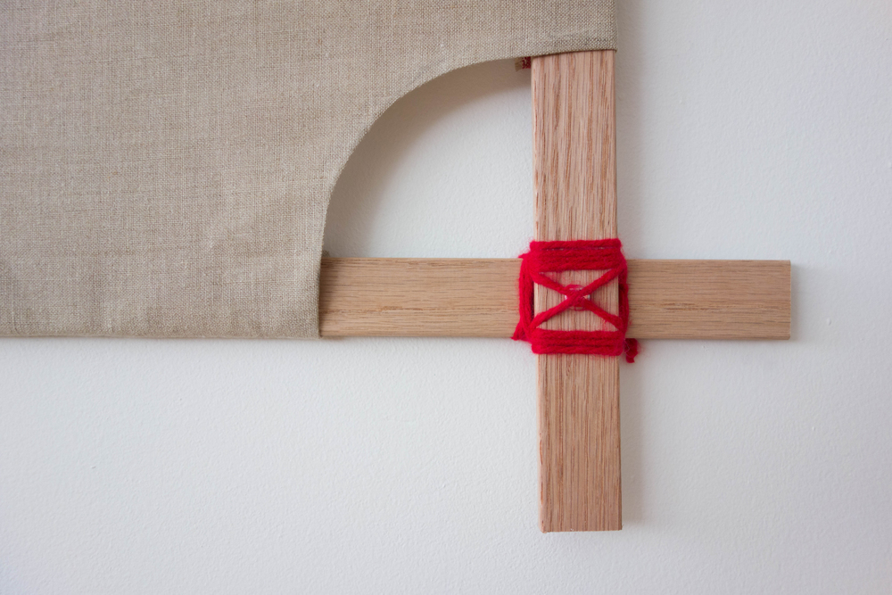 Sewn linen wrapped around oak frames held together by Japanese square knots