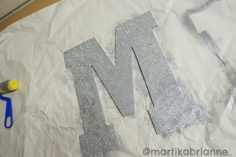 Spray glue, then sprinkle the glitter evenly!