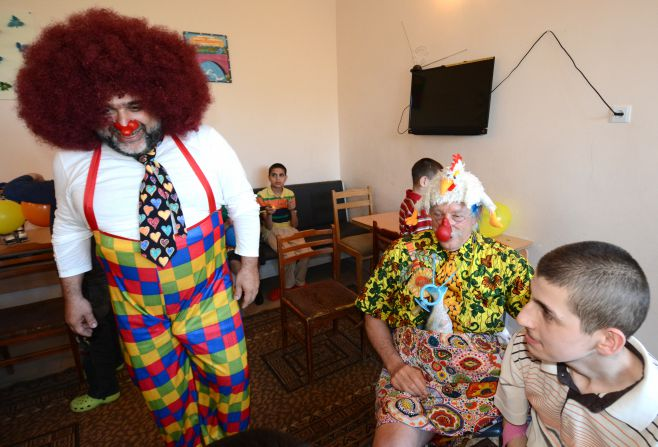 Ruben Vardanian and Patch Adams at an Orphanage in Armenia                                   Photo: Italo Bertolasi / For MT