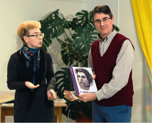 Alla Pavlovna presenting a book about a local artist, after the lecture.      Photo: Andrei Kiryanov