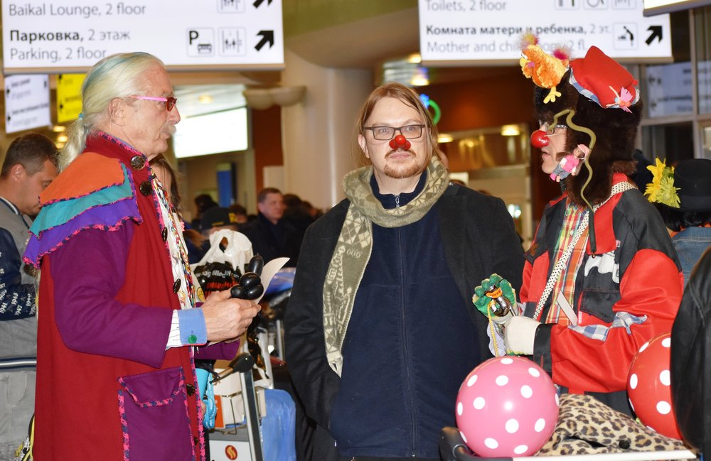 Clowns contemplating how to retrieve lost luggage