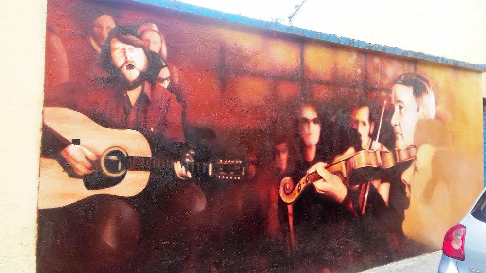 Mural on the wall across from McLynn's pub, where Thom got his start in Sligo.