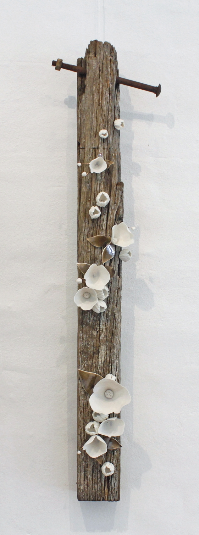 Amy Hick  Fence Post no.2 2015.   Hand built imperial porcelain, weathered fence post, clear glaze, bronze glaze, copper wire, approximately 90x21x14cm. SOLD  Photography: Madeline Young