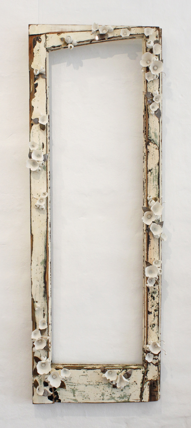 Amy Hick,  French Door no.2 , 2015. Hand built imperial porcelain, French door frame, clear glaze, bronze glaze, copper wire, approximately 144x50x10cm  Photography: Madeline Young
