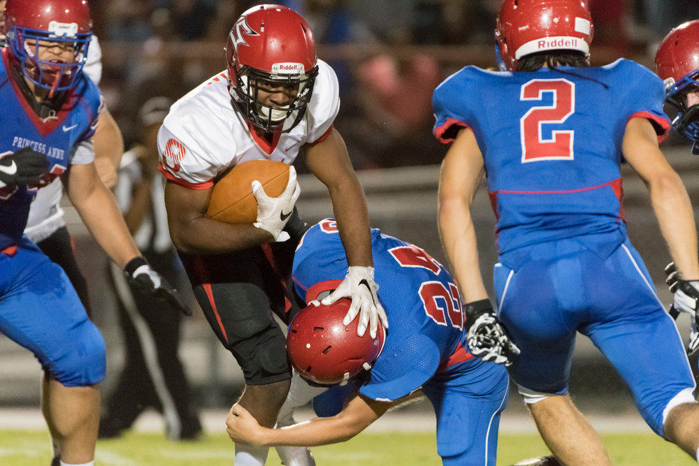 Salem running back Davonte Williams works to break a tackle by Princess Anne linebacker Nick Peal during Friday night's game.