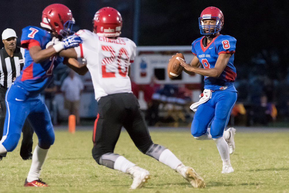 Princess Anne quarterback Michael Vickers looks for an open receiver during Friday night's game against Salem.