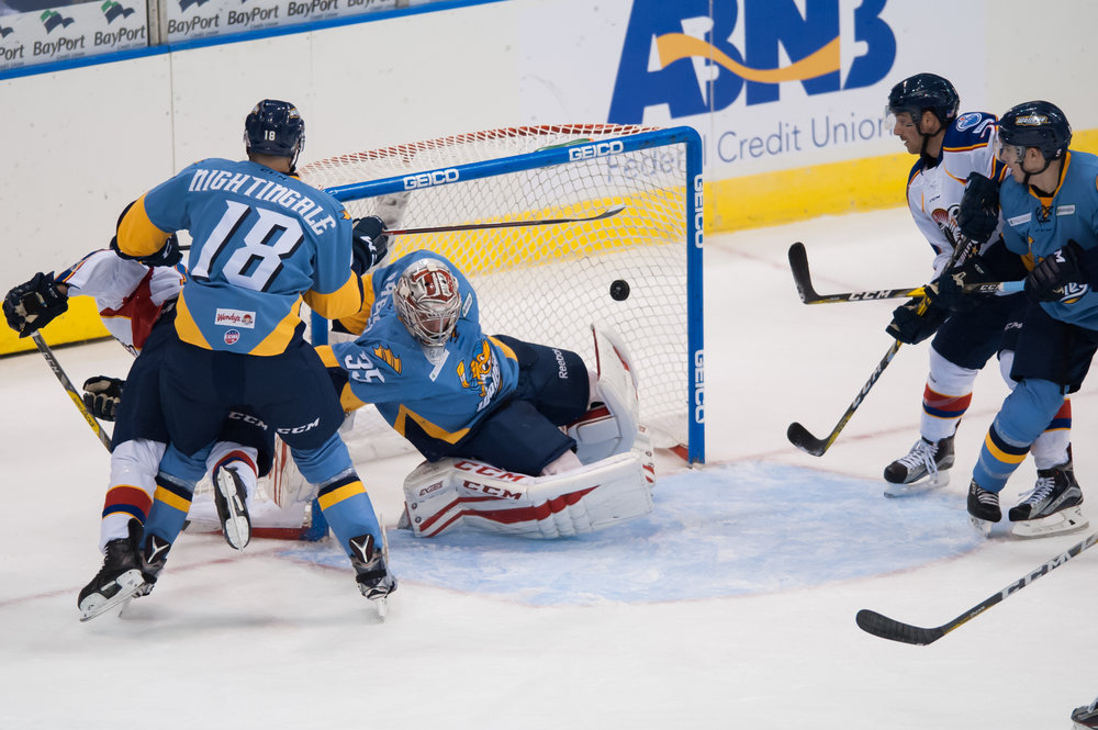 Toledo Walleye goalie Jake Paterson (35) blocks a shot by Norfolk Admirals forward Mike Seidel during Saturday night's game at the Scope Arena in Norfolk, Virginia. Toledo defeated Norfolk 4 to 1.