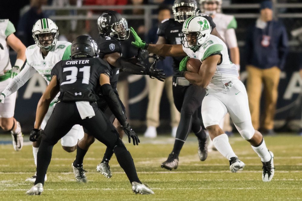 Marshall Thundering Herd running back Tony Pittman (23) works past Old Dominion Monarchs safety C.J. Bradshaw (3) during the Saturday, November 5th game at Forman Field in Norfolk, Virginia. Old Dominion leads Marshall 21 to 7 at the half.