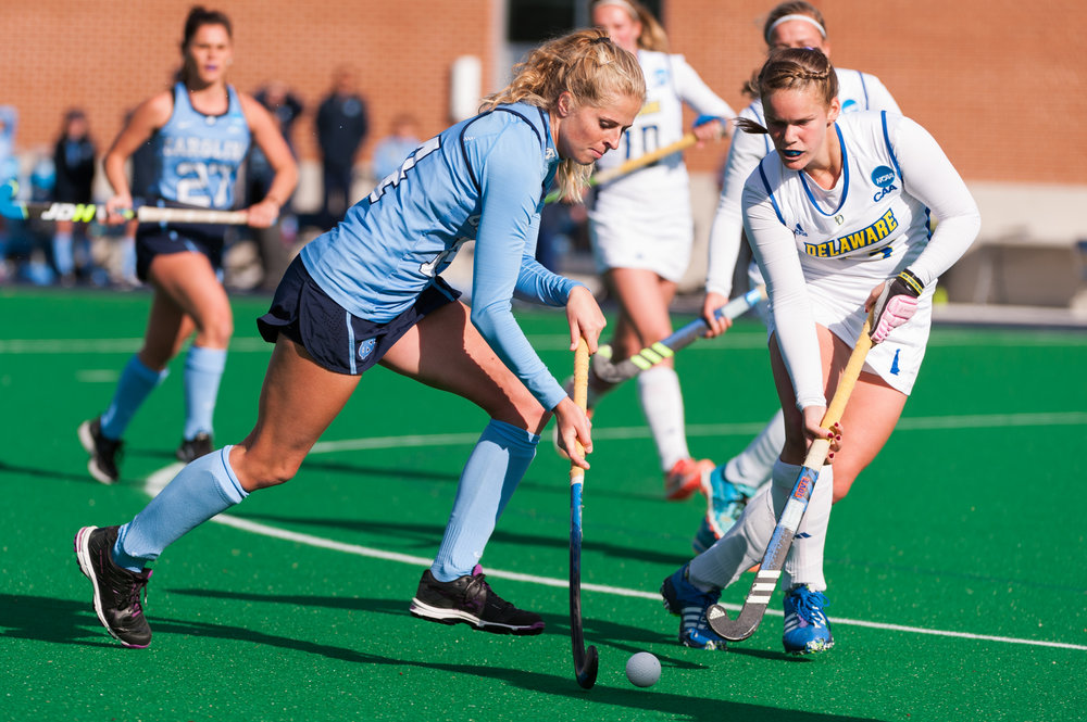 North Carolina midfielder Emma Bozek (14) moves the ball past Delaware midfielder Kayla Devlin (13) during the 2016 NCAA DI National Championship at the L.R. Hill Sports Complex in Norfolk, VA. Delaware defeated North Carolina 3-2.
