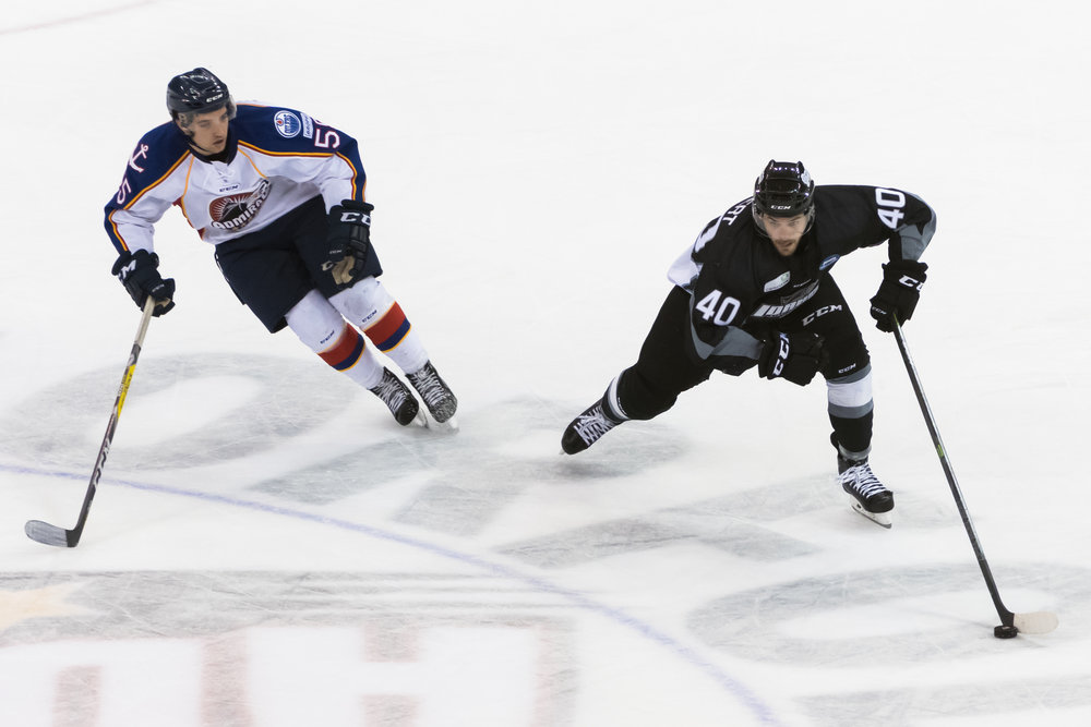 Idaho Steelheads forward Caleb Herbert (40) moves the puck by Norfolk Admirals center Jeff DiNallo (55) during Saturday night's game at the Scope Arena in Norfolk, Virginia. Idaho defeated Norfolk 4-1.