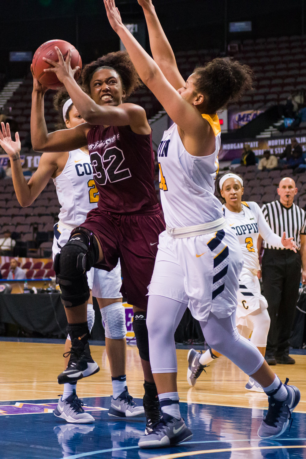 Maryland Eastern Shore Lady Hawks guard Keyera Eaton (32) goes up for a shot against Coppin State Lady Eagles forward Tiara Goode (14) during the 2017 MEAC Tournament held at the Scope Arena in Norfolk, VA. Maryland Eastern Shore defeated Coppin State 62-59.