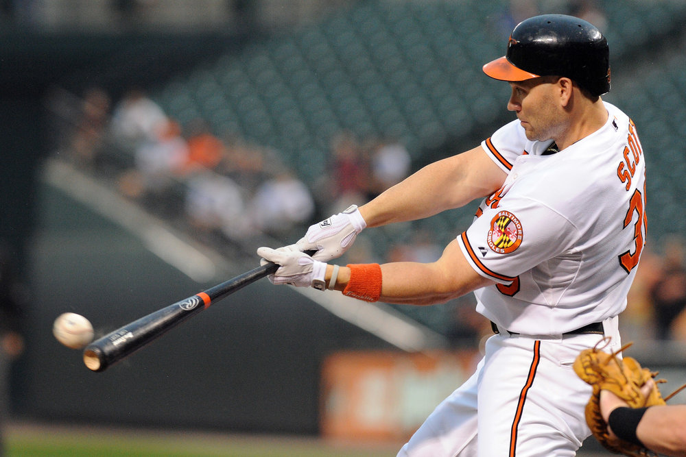 Baltimore Orioles designated hitter Luke Scott (30) swings at a pitch during the first inning of Wednesday night's game against the Seattle Mariners at Camden Yards in Baltimore, MD. The Seattle Mariners defeated the Baltimore Orioles 6-5.