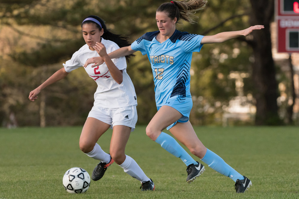 First Colonial midfielder Abigail Wagner (12) and Princess Anne midfielder jessica White (2) fight for the ball during the Tuesday, April 4th game at Princess Anne High School.