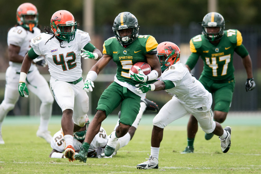 Norfolk State Spartans wide receiver Marcus Taylor (5) works to break a tackle by Florida A&M Rattlers running back Bishop Bonnett (36) during the Saturday, October 7th 2017 game held at Dick Price Stadium in Norfolk, Virginia. Norfolk State defeated Florida A&M 35-28.