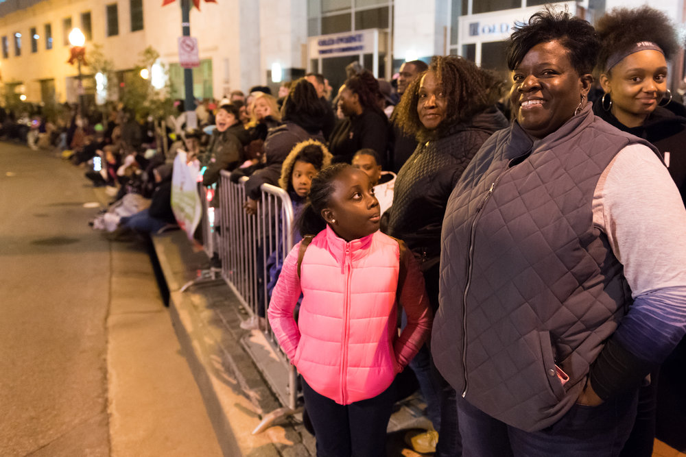 Valerie Ricks-Bell and her daughter Daijah Bell waits for the parade to start before the 33rd Annual Grand Illumination Parade on Saturday, November 18, 2017.