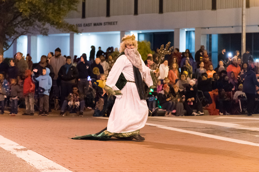 King Neptune entertains the crowd during the 33rd Annual Grand Illumination Parade on Saturday, November 18, 2017.