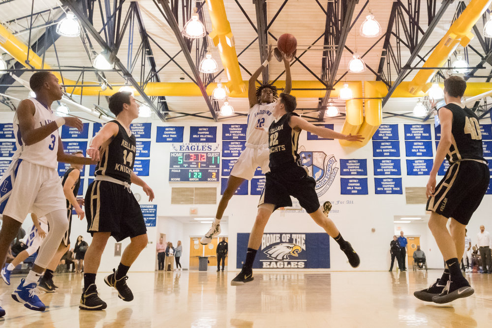 Landstown's Lamont Elephant goes up for a shot under pressure from Kellam's Colin Lee during the Friday, January 2nd game. Landstown defeated Kellam 53 to 51 in overtime.