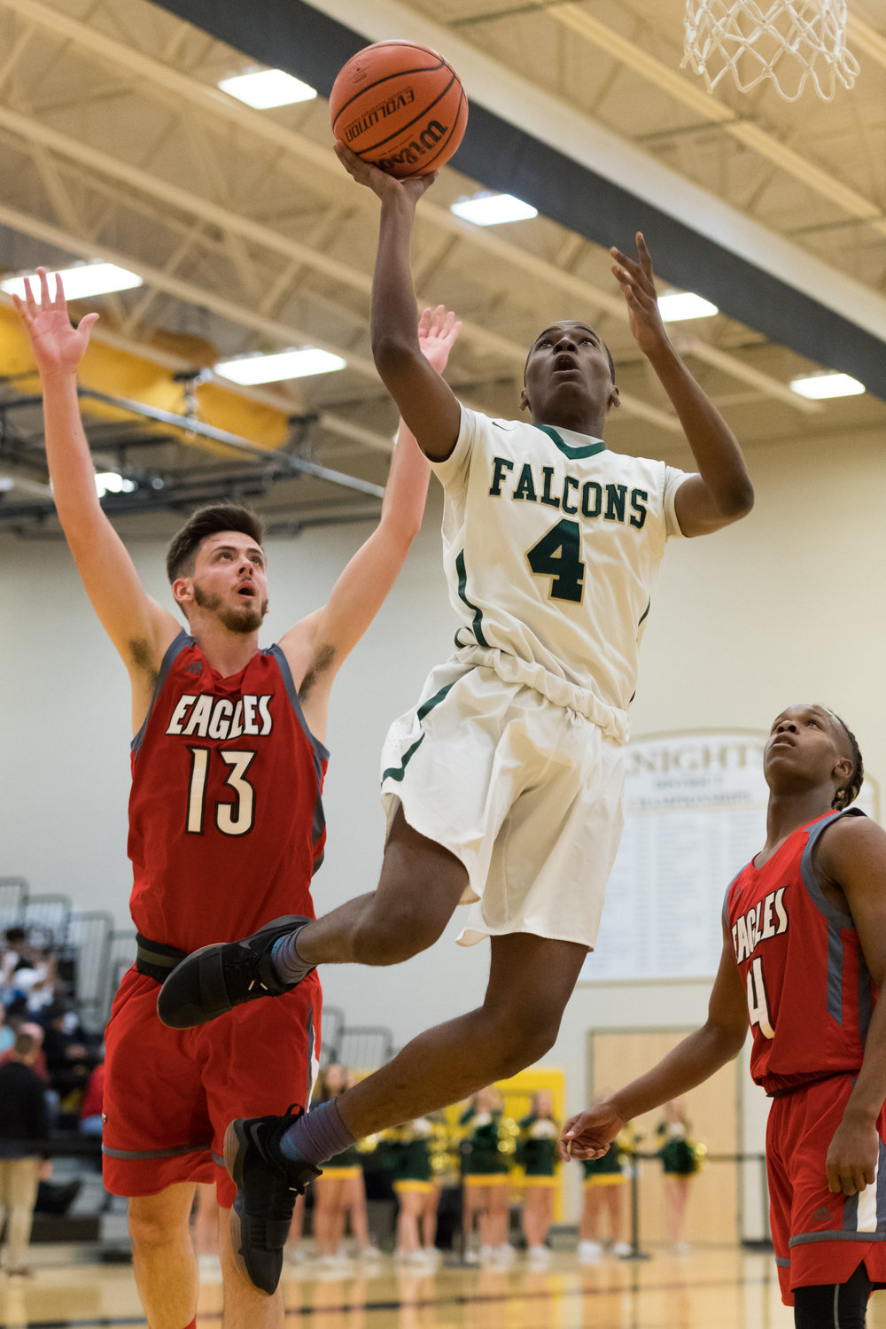 Cox's Deshawn Creighton goes up for a shot in front of Franklin's Nathan Brooks during the Saturday, March 3, 2018 game held at Kellam High School.