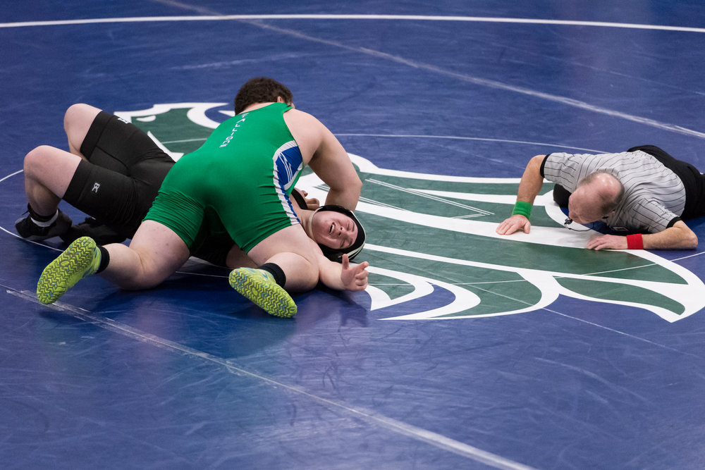 Green Run's Peter Cortapasco works to pin Hickory's Elijah Hoar during the 285 pound match at the VHSL Region 5A East Sectional held Saturday, February 3, 2018 at Green Run High School.
