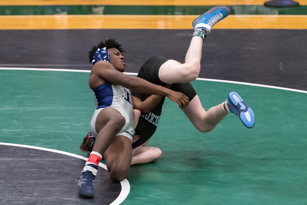 Indian River's Tyrion Smith tosses Hickory's Tyler McCormick during the 145 pound match at the VHSL Region 5A East Sectional held Saturday, February 3, 2018 at Green Run High School.
