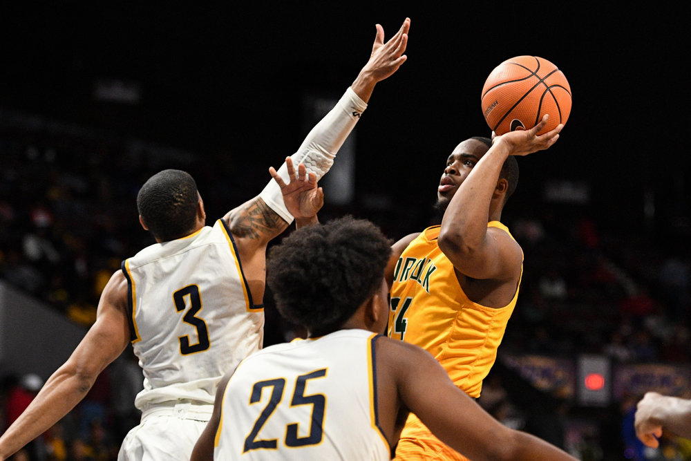 Norfolk State Spartans guard Steven Whitley takes a shot against North Carolina A&T Aggies guard Devonte Boykins during the Thursday, March 8, 2018 game held at Norfolk Scope Arena.