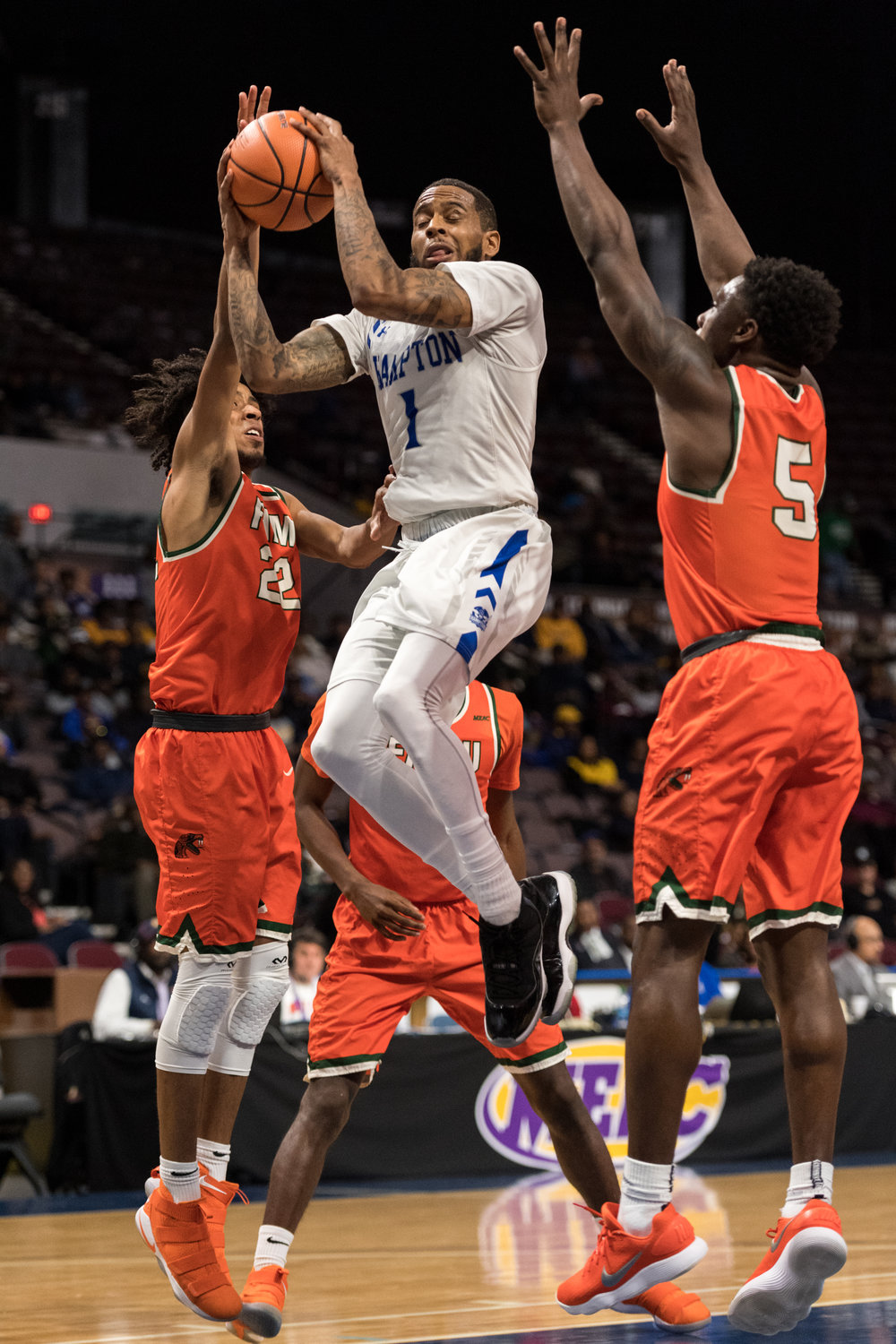 Hampton Pirates guard Malique Trent-Street (1) takes a shot against Florida A&M Rattlers guard Marcus Barham (22) and guard Nasir Core (5) during the Wednesday, March 7, 2018 game held at Norfolk Scope Arena. Hampton defeated Florida A&M 75 to 71.