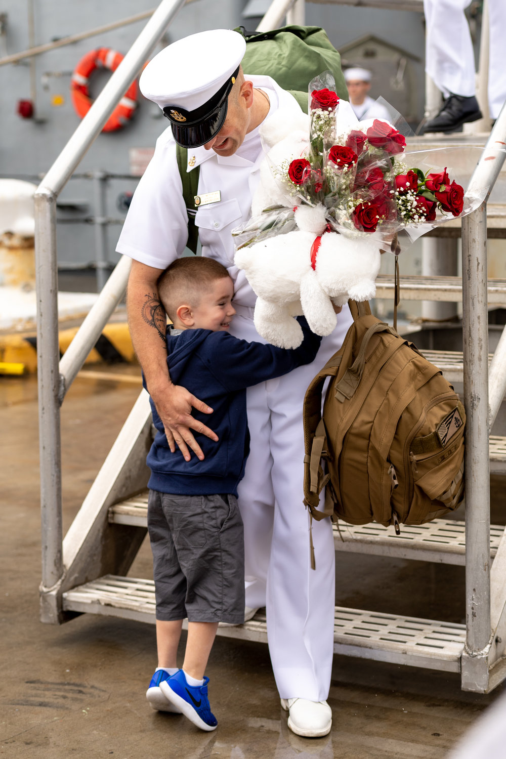 Senior Chief Culinary Specialist Timothy Whitman  is greeted by his son, Timothy Michael, after the USS Monterey returned to Naval Station Norfolk on Sunday, May 6, 2018. The USS Monterey is returning from a seven month deployment to the Navy's 5th and 6th Fleets, culminating in missile strikes against Syria in April.