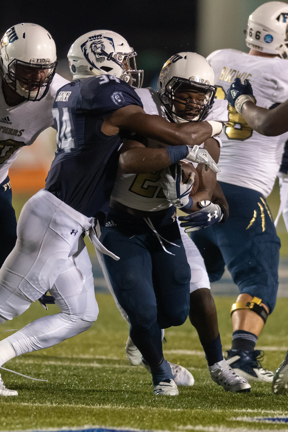 FIU Panthers running back Shawndarrius Phillips (22) runs the ball under pressure from Old Dominion Monarchs cornerback Joe Joe Headen (24) during the Saturday, Sept. 8, 2018 game held at Old Dominion University in Norfolk, Virginia. The Monarchs lead 14 to 0 during the second quarter.