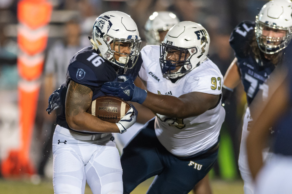 FIU Panthers defensive lineman Teair Tart (93) works to tackle Old Dominion Monarchs running back Brandon Sinclair (16) during the Saturday, Sept. 8, 2018 game held at Old Dominion University in Norfolk, Virginia. The Monarchs lead 14 to 0 during the second quarter.