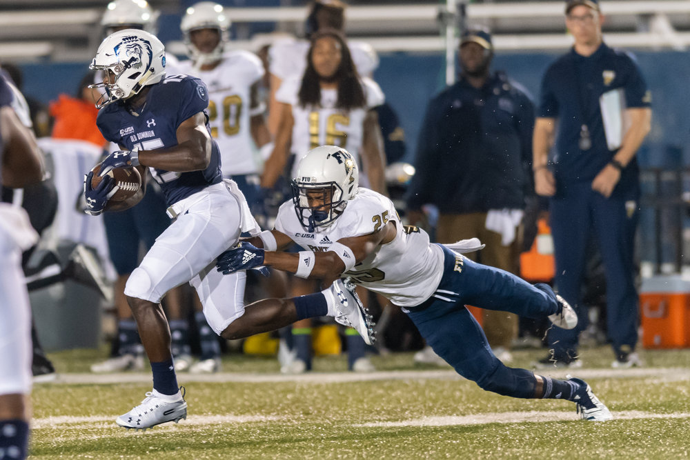 Old Dominion Monarchs wide receiver Isaiah Harper (15) works to escape FIU Panthers defensive back Aris Duffey (25) during the Saturday, Sept. 8, 2018 game held at Old Dominion University in Norfolk, Virginia. FIU defeated Old Dominion 28 to 20.