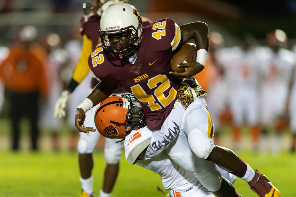 Booker T Washington's Jerome Jones runs the ball against Churchland during the Friday, September 28, 2018 game at Booker T Washington High School. Booker T Washington leads Churchland 21 to 6 in the second quarter.
