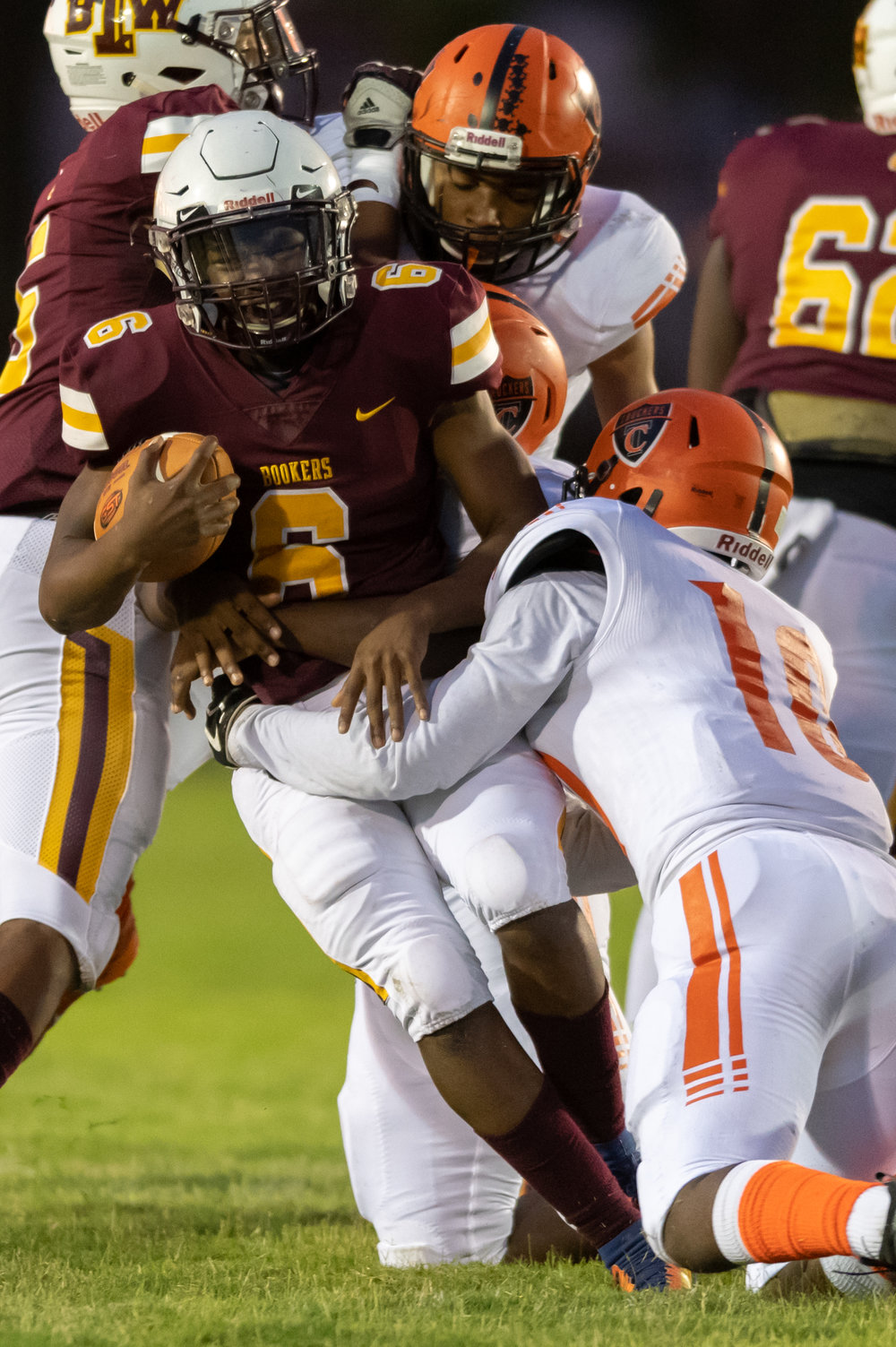 Booker T Washington's Rodney Hammond works to break a tackle by Churchland's Jarel Ware during the Friday, September 28, 2018 game at Booker T Washington High School. Booker T Washington leads Churchland 21 to 6 in the second quarter.