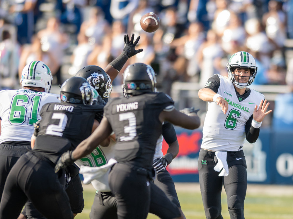Marshall Thundering Herd quarterback Alex Thomson (6) makes a pass under pressure from the Old Dominion Monarchs during the Saturday, Oct. 13, 2018 game held at Old Dominion University in Norfolk, Virginia. Marshall leads Old Dominion 14 to 3 at halftime.