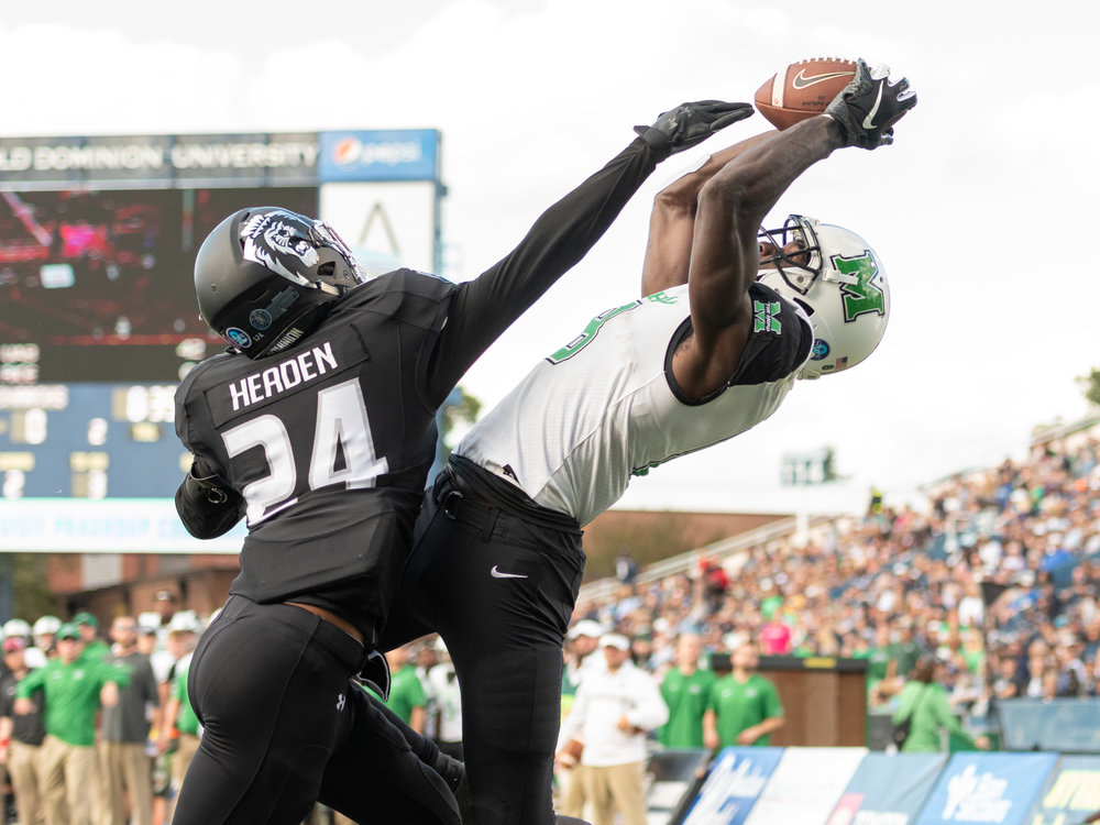 Marshall Thundering Herd wide receiver Tyre Brady (8) catches a touchdown pass against Old Dominion Monarchs cornerback Joe Joe Headen (24) during the Saturday, Oct. 13, 2018 game held at Old Dominion University in Norfolk, Virginia. Marshall leads Old Dominion 14 to 3 at halftime.