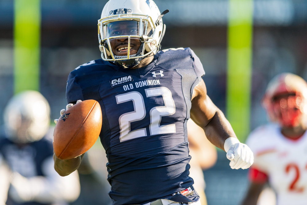 Old Dominion Monarchs safety Justin Noye (22) runs the ball for a touchdown after making an interception against the Virginia Military Institute Keydets during the Saturday, Nov. 17, 2018 game held at Old Dominion University in Norfolk, Virginia. Old Dominion leads VMI 49 to 0 at halftime.