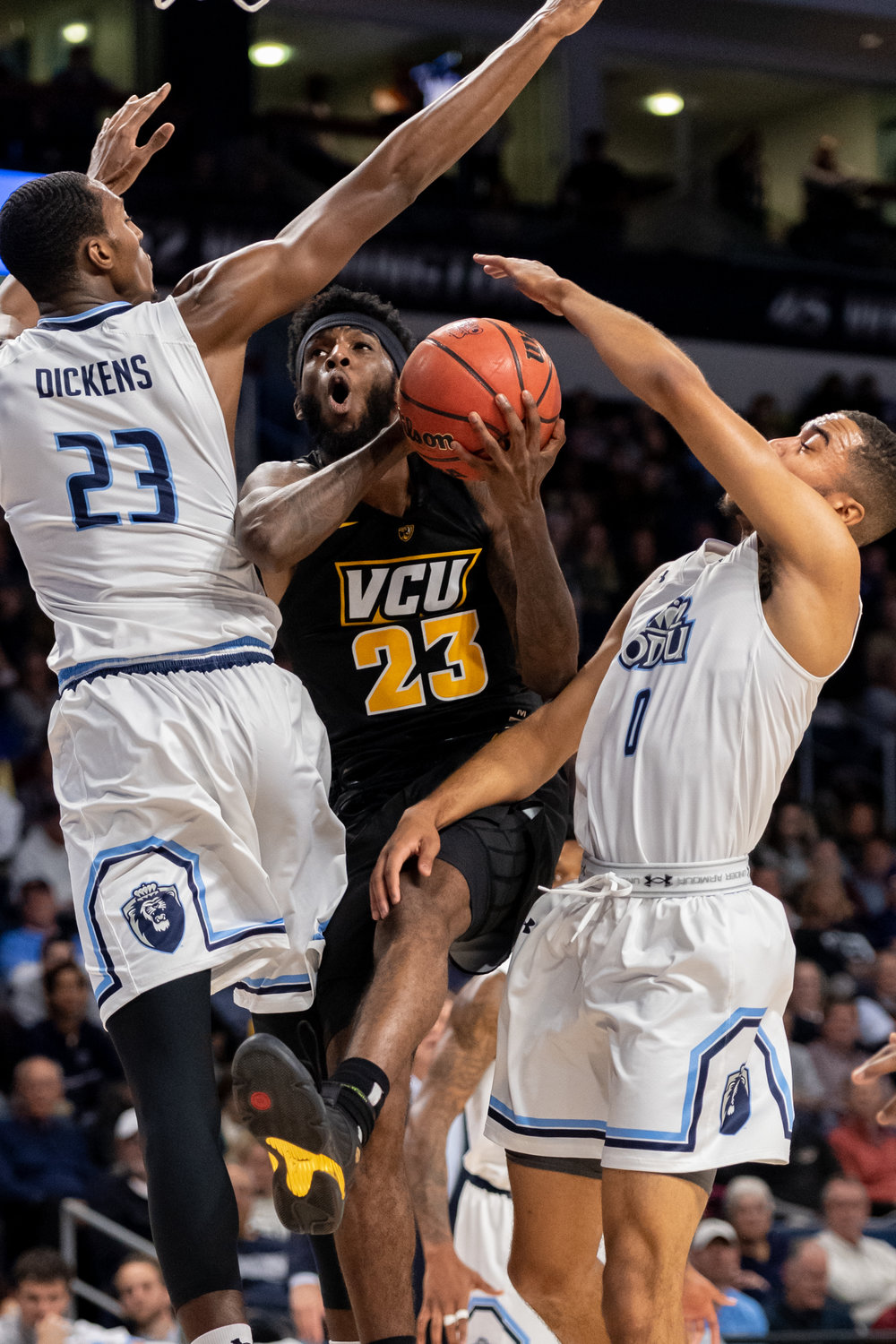Virginia Commonwealth Rams forward Issac Vann (23) takes a shot against Old Dominion Monarchs forward Dajour Dickens (23) and guard Marquis Godwin (0) during the Wednesday, November 28, 2018 game held at Old Dominion University in Norfolk. Old Dominion defeated VCU 62 to 52.