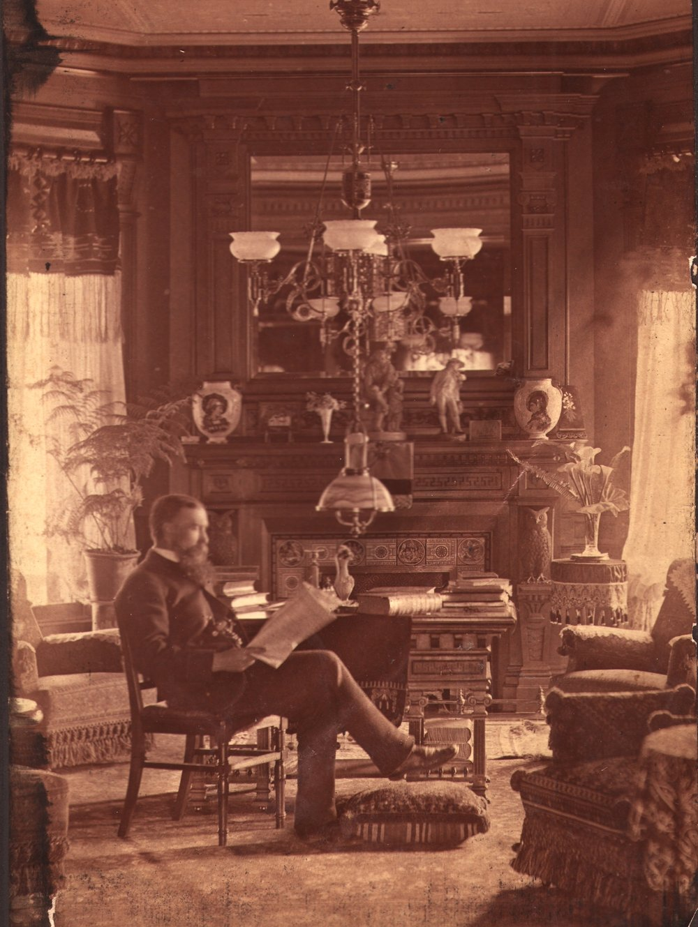 Bronson B. Tuttle in his library, 1883