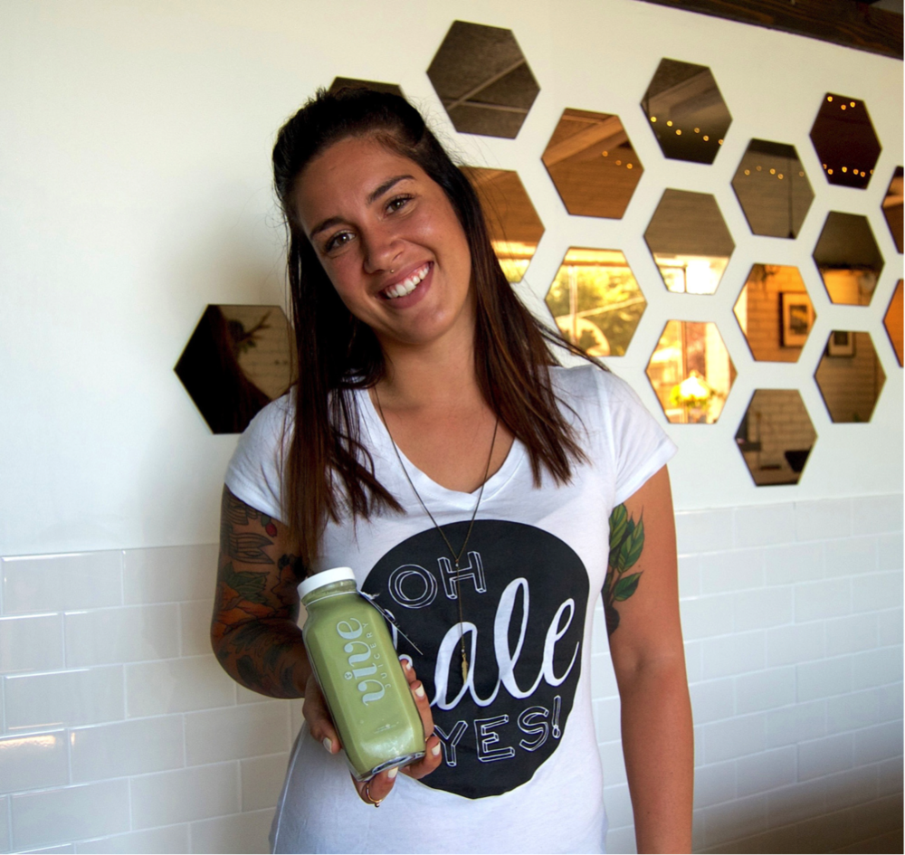 Photos by catherine blakemore Owner and founder of vive juicery, brittany thaxton, holding her favorite juice (of the moment), the matcha glow
