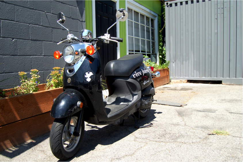 one of the original vespas that the thaxton's used to deliver juice.
