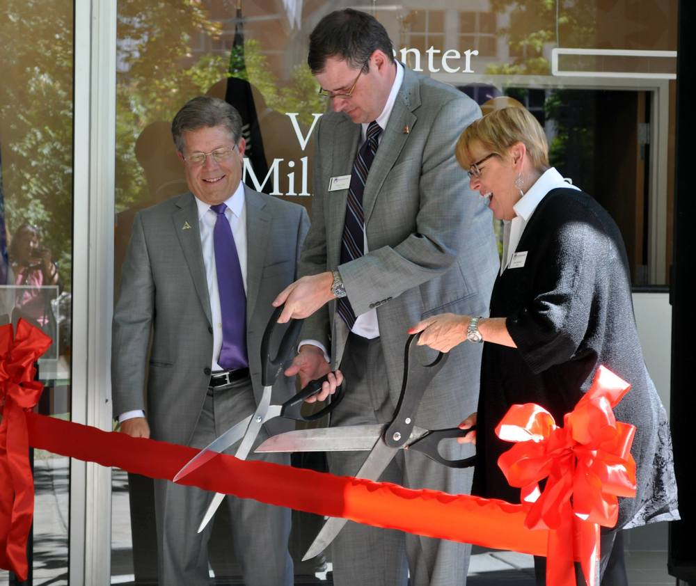 There was not a dull moment at the opening ceremony for the new Center for Veteran and Military Services, except for  Westminster trustee Kim T. Adamson's scissors, but with fellow trustee Wood Moyle's help, the ribbon was successfully cut. Photos by Rachel Robertson