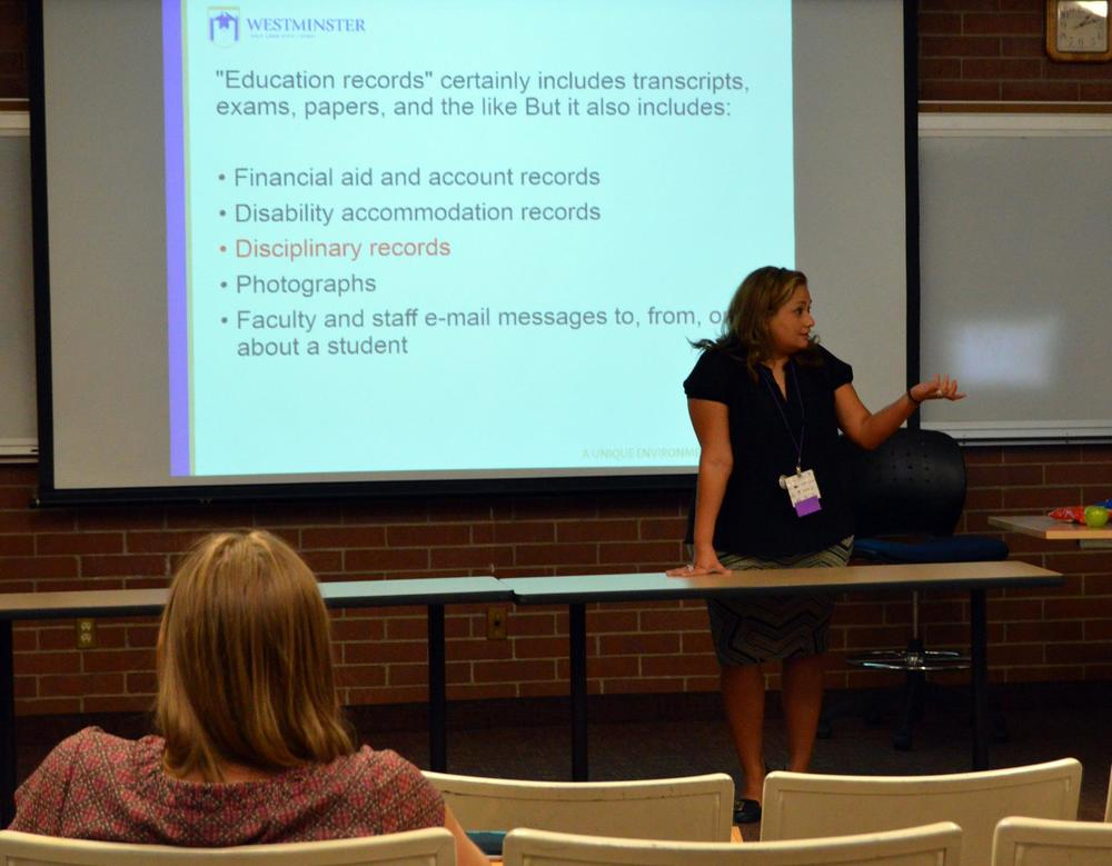 Westminster's General Counsel, Melissa Flores, presents in a breakout session at the symposium.
