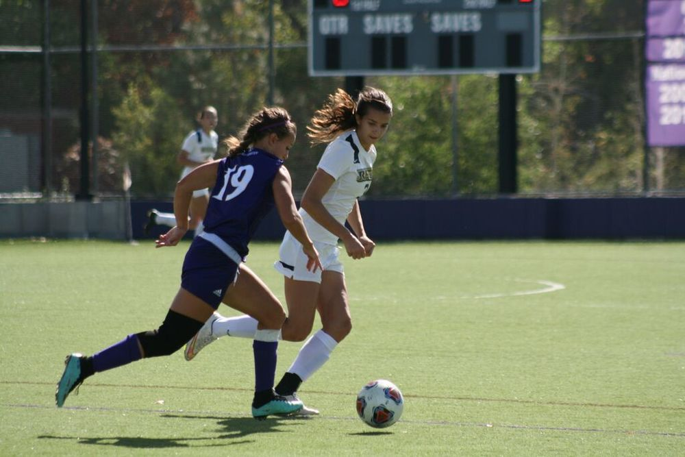 Korral Koehler, defensive player for the Griffins, keeps the ball away from a Regis player at their game on Sunday, Oct. 4. This is the first season the women's soccer team has competed with other NCAA teams.