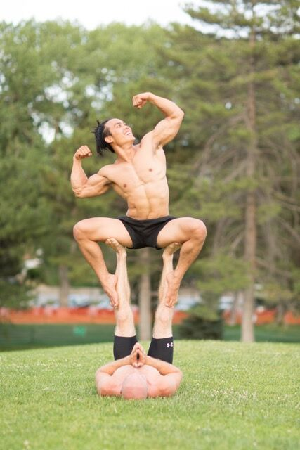 Wai Goh shows off his Acroyoga abilities and muscles with a partner, all while flashing a smile. Acroyoga is the practice of combining acrobatics and yoga and includes positions like preparing for takeoff, high-flying whale and double bird pose. Photo courtesy Wai Goh