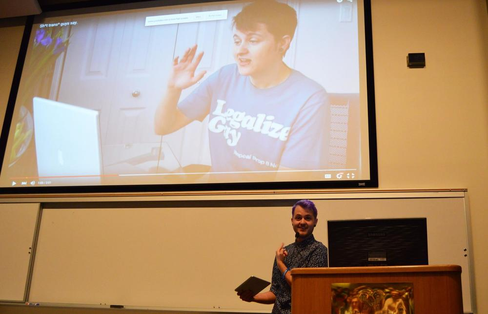 Ross pokes fun at one of his old YouTube videos during his presentation. Ross has become famous in the transgender community for his videos, which explore transgender issues.