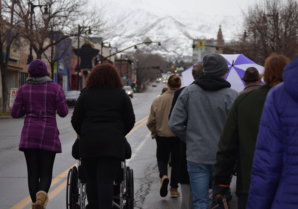 Students, faculty, staff and community members march up 2100 South, honoring Dr. Martin Luther King and his teachings. The marchers chanted and walked through the misty rain for about an hour before the keynote speaker in Gore Auditorium. Photos by Rachel Robertson