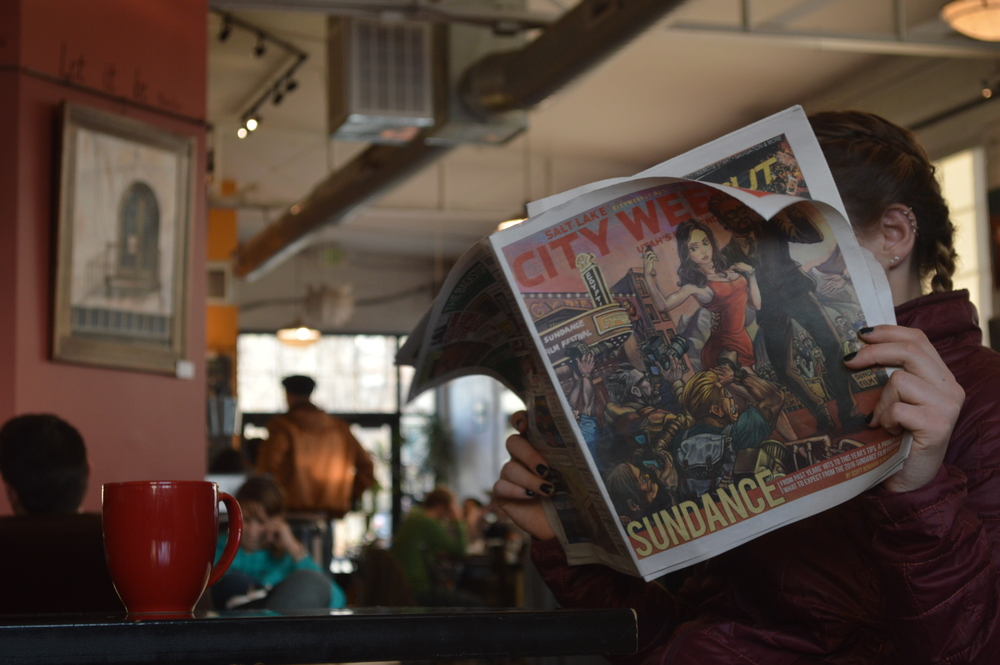 Madison Mansfield, a sophomore biology major, reads the City Weekly Sundance issue at Sugar House Coffee. The Sundance Film Festival offers internships, volunteer opportunities and many other ways for Westminster students to get involved. Photo by Olivia Wathne