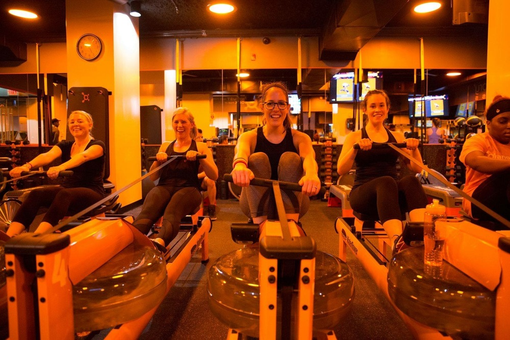 Photo courtesy Orangetheory Fitness Salt Lake. Members of the Salt Lake Orangetheory get in a good workout. Instructors have participants rotate between treadmills, water rowers and the weight floor during the one-hour session, all while helping with correct form and maintaining motivation.