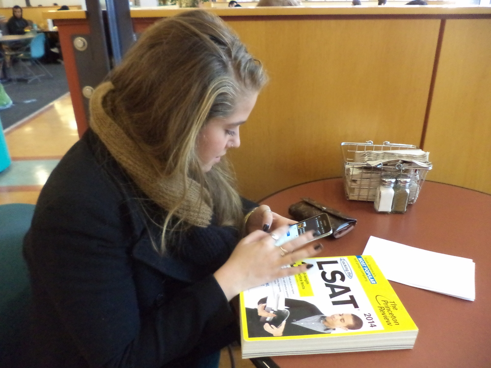 Sierra Baker, senior, uses her phone before studying in the Shaw Student Center on Jan. 21. Baker said that her multitasking usually includes Netflix, TV or music.