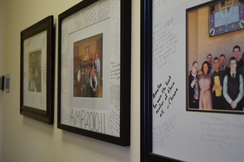 Previous participants of the AMP program gave Alumni Relations Director, Annalisa Holcombe, the photographs that hang outside her office in Converse Hall. Holcombe said AMP is one of the best gifts students can give to themselves.